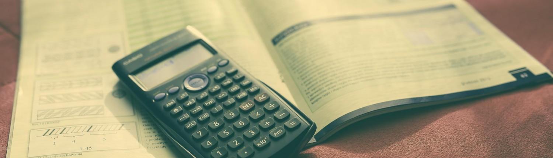 maths book and calculator